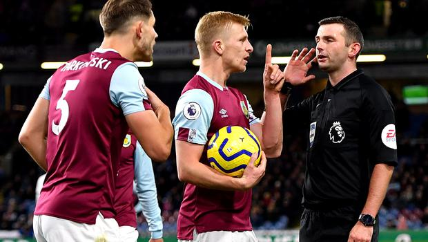 Match referee Michael Oliver waits for the VAR decision after Chelsea's Callum Hudson-Odoi goes down in the penalty area in Burnley (Anthony Devlin/PA)