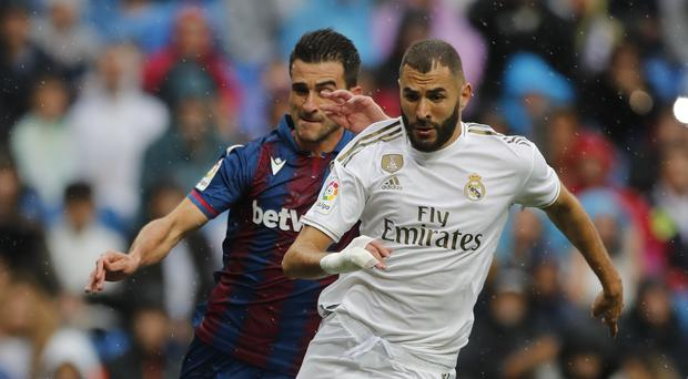 Karim Benzema, right, scored twice for Real (Bernat Armangue/AP)
