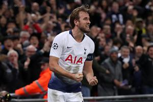 Harry Kane celebrates the late winner against PSV Eindhoven which kept Tottenham in the Champions League (Adam Davy/PA)