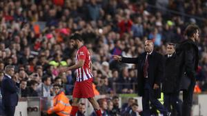 Diego Costa passes his coach, Diego Simeone, right, after he was sent off for abusing a referee in Atletico Madrid's loss at Barcelona (AP)