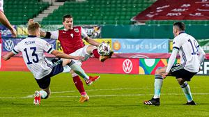 Ali McCann, left, made his Northern Ireland debut in the Austria defeat (Florian Schrotter/PA)