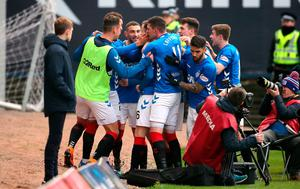 You beauty: Andy Halliday is mobbed after his goal but Gers could not find a winner