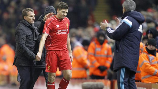 Liverpool manager Brendan Rodgers pats Steven Gerrard (centre) on the back after after being substituted against Chelsea