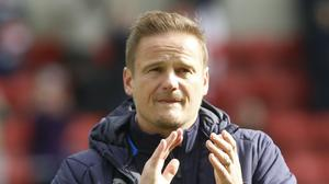 The future is unclear for Notts County manager Neal Ardley and the other National League teams (PA)