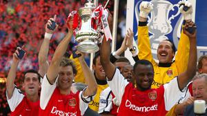 Arsenal captain Tony Adams, left, and Patrick Vieira lifted the FA Cup in Cardiff (PA)