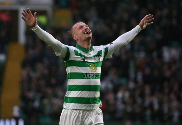 Leigh Griffiths hit a hat-trick in a 5-0 win over St Mirren in what proved to be Celtic's final game of the season (PA)