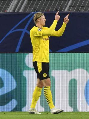 Erling Haaland celebrates his first goal against Club Brugge (Martin Meissner/AP)