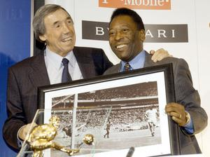 Banks, left, with Pele, and a photograph of the former's iconic save from the latter during the 1970 World Cup finals in Mexico. (Stefan Rousseau/PA)