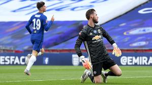 Chelsea's Mason Mount (left) celebrates scoring his side's second goal of the game as Manchester United goalkeeper David De Gea looks on after his mistake (Andy Rain/NMC Pool/PA)