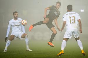 Flying feet: Celtic's Stefan Scepovic leaps to win the ball during their 1-1 with Astra Giurgiu in Romania
