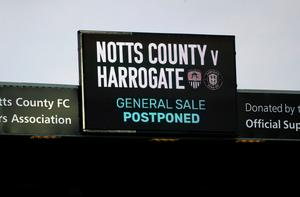 Off the schedule: A sign for the postponed Notts County v Harrogate game, with the FA expecting a £100m shortfall