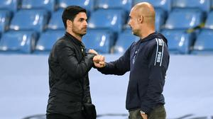 Arsenal head coach Mikel Arteta (left) worked under Pep Guardiola at Manchester City. (Peter Powell/NMC Poll)