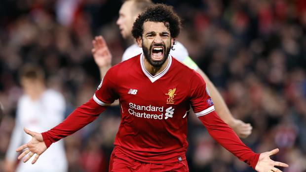 Mohamed Salah celebrates a Champions League goal