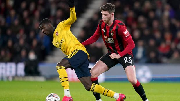Bournemouth's Jack Simpson (right) and Arsenal's Eddie Nketiah�battle for the ball during the FA Cup fourth round match at Vitality Stadium, Bournemouth.