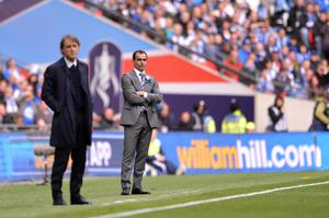 Roberto Mancini, left, and Roberto Martinez suffered different fates after the game (Anthony Devlin/PA)