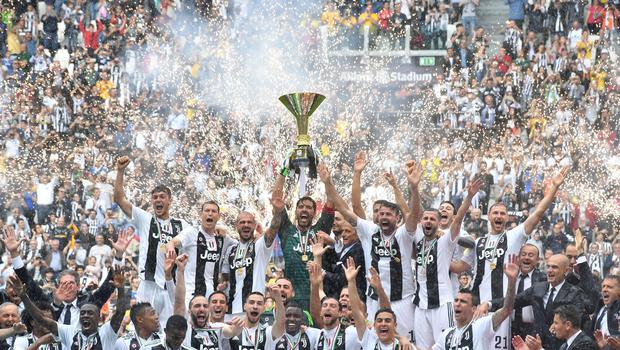 Gianluigi Buffon lifted the Serie A trophy after his final match for Juventus (Alessandro Di Marco/AP)