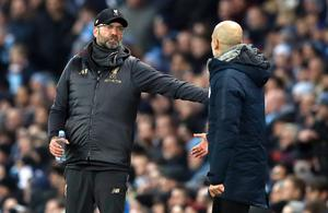 Jurgen Klopp, left, and Pep Guardiola are locked in a battle for the Premier League title (Martin Rickett/PA)