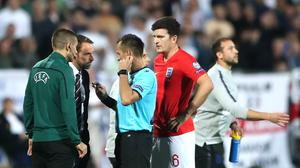 Croatian referee Ivan Bebek speaks to England manager Gareth Southgate and defender Harry Maguire following racist abuse during the Euro 2020 qualifier in Sofia (Nick Potts/PA)
