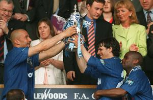 Gianluca Vialli, left, and Gianfranco Zola hold the trophy aloft after Chelsea beat Middlesbrough in the 1997 final (Rebecca Naden/PA)