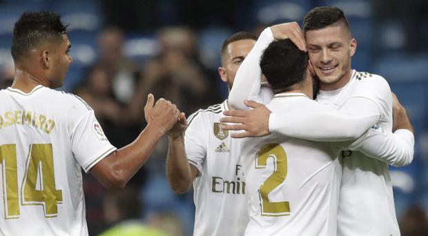 Luka Jovic (right) scored his first goal for Real Mardid after coming off the bench (Bernat Armangue/AP)