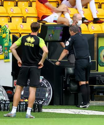 Referee Kevin Friend checks the VAR monitor in a match between Norwich and Burnley (Julian Finney/NMC Pool/PA)