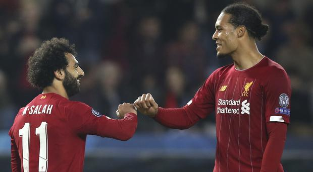 Virgil Van Dijk (right) and a defence missing 50 per cent of its regular starters were stretched until the second goal went in (Francisco Seco/AP)