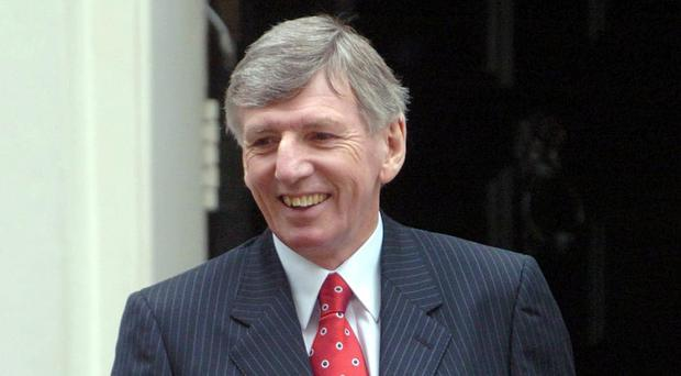 Martin Peters leaves 11 Downing Street, London, Tuesday March 21, 2006, after team members of the England and German 1966 World Cup teams had lunch with Chancellor Gordon Brown. See PA story SPORT England. PRESS ASSOCIATION Photo. Photo credit should read: Ian Nicholson/PA