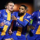 Jason Cummings, left, scored twice for Shrewsbury after coming off the bench (Nick Potts/PA)