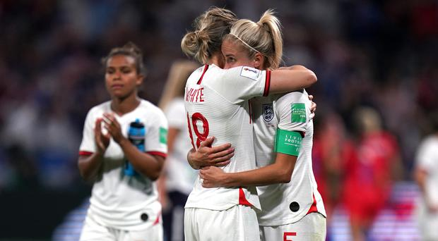 Ellen White, left, and captain Steph Houghton, right, look dejected after their Women's World Cup semi-final exit (John Walton/PA)