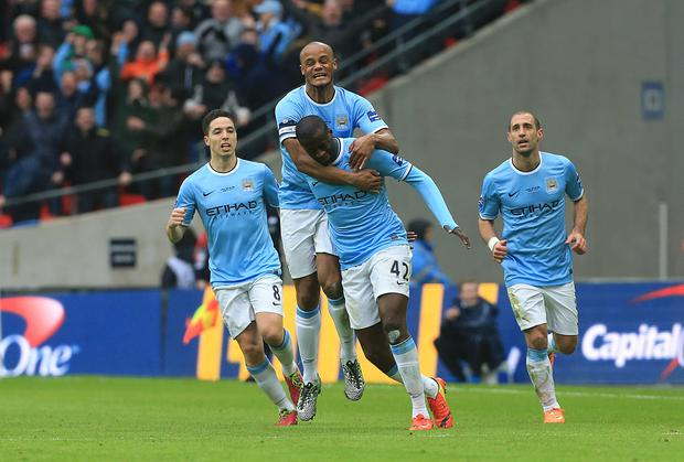 Yaya Toure is congratulated after scoring Manchester City's equaliser (Nick Potts/PA)