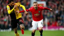 Manchester United's Luke Shaw (right) battles for the ball with Watford's Etienne Capoue at Old Trafford.