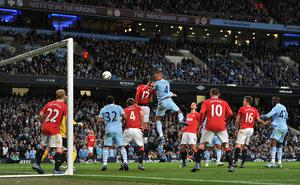 Kompany's goal against Manchester United was a key turning point in the 2012 title race (Martin Rickett/PA)