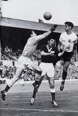 Big game: (left) Harry in action for Northern Ireland during their famous 3-2 win over England at Wembley in 1957