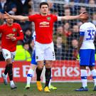 Manchester United's Harry Maguire celebrates scoring his side's first goal of the game during the FA Cup fourth round match at Prenton Park, Birkenhead.