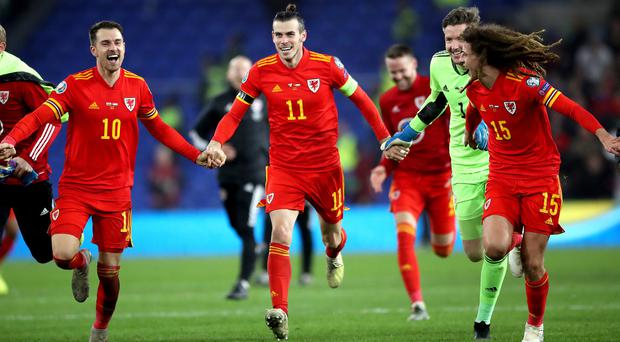 Wales stars (left to right) Aaron Ramsey, Gareth Bale, Wayne Hennessey and Ethan Ampadu celebrate qualifying for Euro 2020 last month (Nick Potts/PA)
