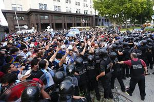 Police block fans waiting to see Maradona lying in state (Marcos Brindicci/AP)