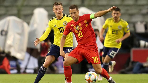 Scotland's Callum McGregor (left) was given the run around by Belgium star Eden Hazard as he played out his 69th game of the season (Bradley Collyer/PA)