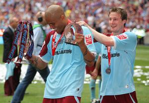 Wembley matchwinnner Wade Elliott (right) celebrates Burnley's promotion to the Premier League with man of the match Clarke Carlisle (left) – (Nick Potts/PA Images).