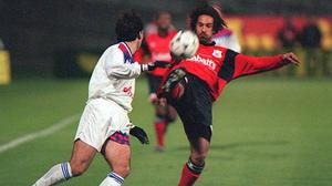 Jason Lee, right, in action for Nottingham Forest in the 1990s (David Jones/PA)