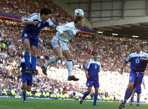 England's Teddy Sheringham scores against Greece to keep alive their hopes of topping Group Nine (Phil Noble/PA)