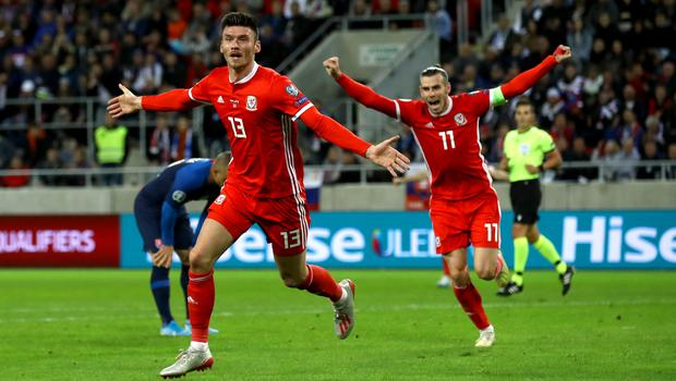 Kieffer Moore, left, scored on his first competitive start for Wales against Slovakia in October (Tim Goode/PA)