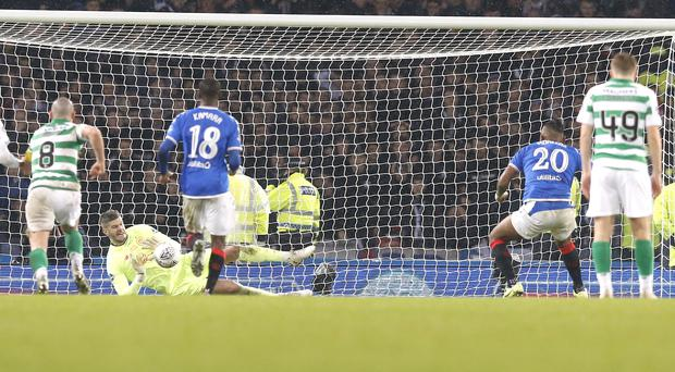 Fraser Forster saved an Alfredo Morelos penalty as Celtic won the Betfred Cup (Jeff Holmes/PA)