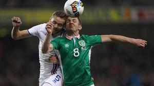 Republic of Ireland striker Kevin Doyle (right) has retired because of concerns over concussion