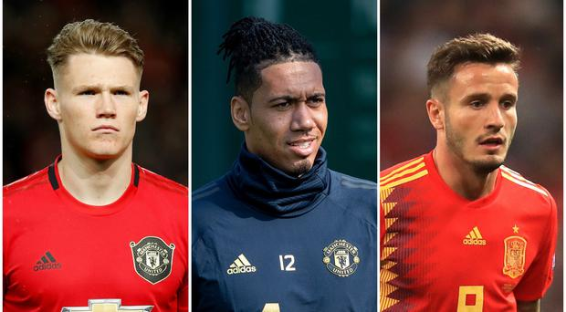 Manchester United are in the news regarding the futures of Scott McTominay, Chris Smalling and Saul Niguez (Martin Rickett/Ian Hodgson/Adam Davy/PA)