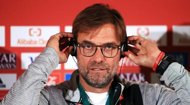 Liverpool manager Jurgen Klopp was keen to keep the focus on footballing matters in Doha (Adam Davy/PA)