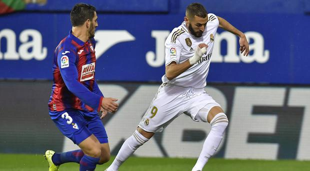Karim Benzema (right) scored two early goals to help put Los Blancos in control (Alvaro Barrientos/AP)