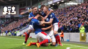 Linfield players celebrate Mark Stafford's goal (Niall Carson/PA)