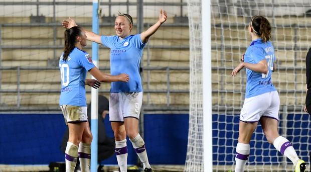 Manchester City's Pauline Bremer celebrates scoring her side's second goal of the game during the Women's Super League match at the Academy Stadium, Manchester.