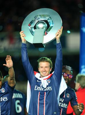 David Beckham celebrates with the Ligue 1 trophy (PA)