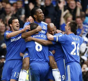 Didier Drogba scored a hat-trick as Chelsea clinched the title in style against Wigan (Nick Potts/PA)